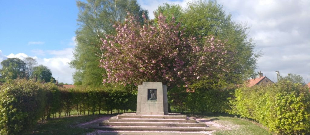 Agnes Hunt memorial stone under cherry blossom
