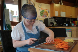 Hospitality and Food student preparing carrots in the training kitchen
