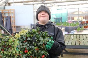 Derwen College student makes wreaths for Garden Centre shop