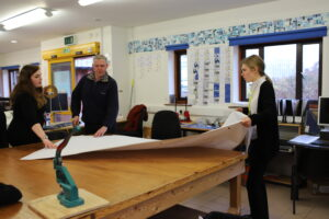 Students at work in the Karten Print Shop - picture here with Governor Paul Milner
