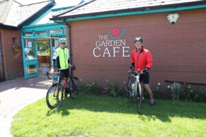 Cyclists outside the Walled Garden Cafe