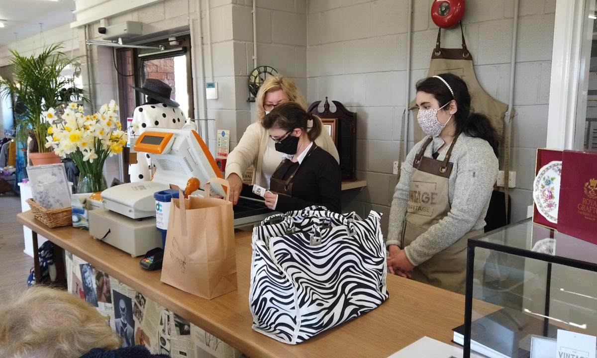 Students serving a customer in The Vintage Advantage at Derwen College